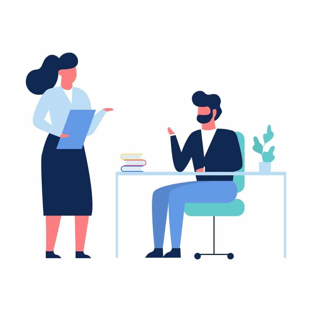Deux personnes parlant au bureau
