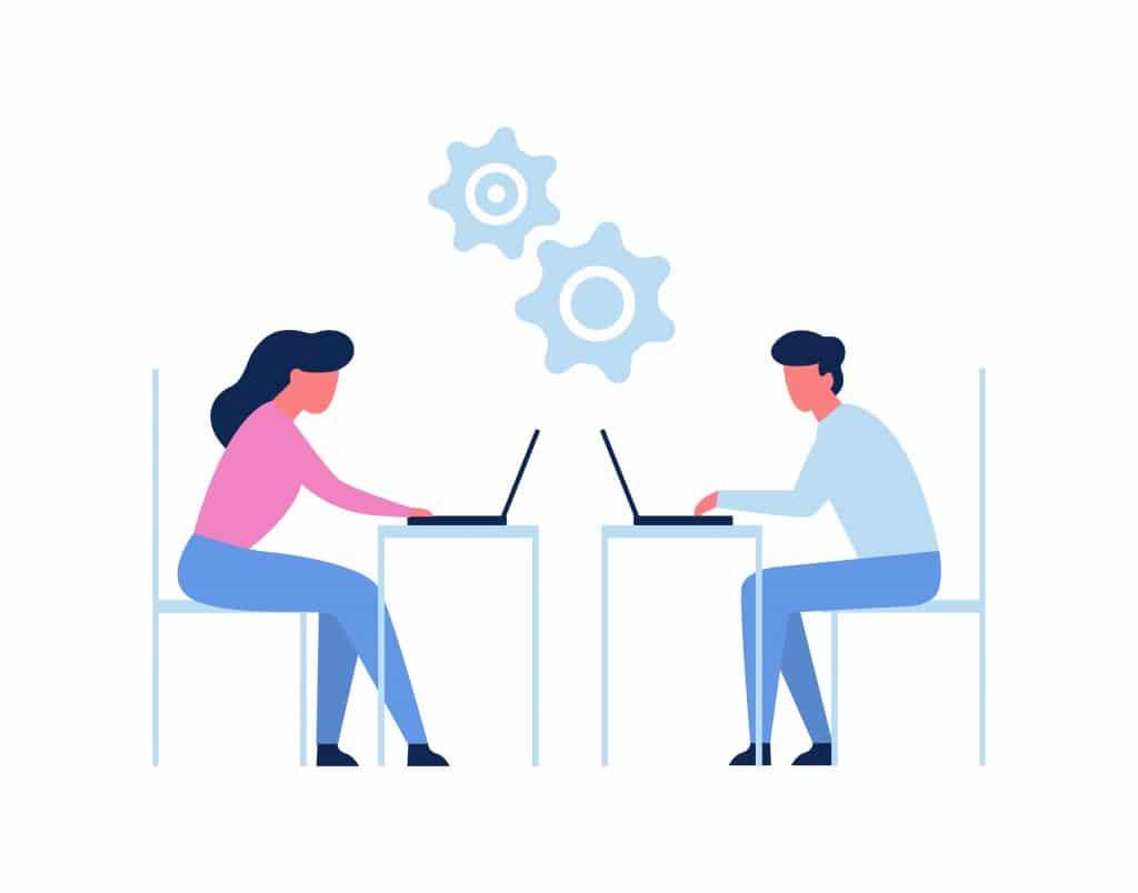 Des personnes travaillant sur un ordinateur portable au bureau